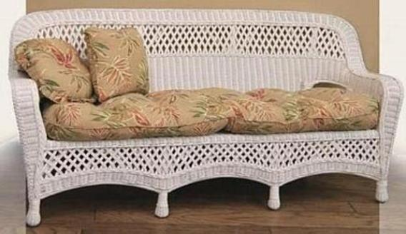 wicker sofa pictured in white